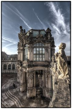 The Zwinger (Der Dresdner Zwinger) is a palace in Dresden, eastern Germany, built in Rococo style and designed by court architect Matthäus Daniel Pöppelmann. It served as the orangery, exhibition gallery and festival arena of the Dresden Court.    The location was formerly part of the Dresden fortress of which the outer wall is conserved. The name derives from the German word Zwinger (outer ward of a concentric castle); it was for the cannons that were placed between the outer wall major…