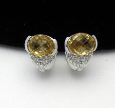 Judith Ripka Sterling Collection  http://stores.ebay.com/atouchofrosevintagejewels