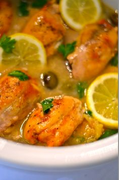 This recipe calls for boneless chicken thighs, fresh squeezed lemon, olives, and a winning combination of flavorful spices.  Yum!  #slowcooker #lemon #chicken