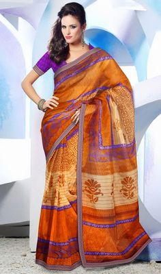 Captivating Orange Printed Saree You Will Be The Center Of Attention In This Attire. An Outstanding Orange Saree Will Make You Look Very Stylish And Graceful.Comes with a matching stitched round neck blouse with 6 inches sleeves .  #BuyPrintedSarees #DesignerPrintedSilkSarees