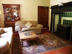 Farchynys Hall's comfy living room with a wood burning stove.
