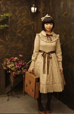 Lolita Fashion | Classical.  Love this so much, her hair is perfect~ Lolita Fashion is not understood well by non devotees. Often no expense or effort is spared in the careful classic designs. Usually hand made by seamstress artists. The look it put together by the wearer. -vb