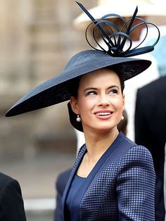 LADY FREDERICK WINDSOR Born Sophie Winkleman, the daughter-in-law of the Duke and Duchess of Kent, is in the navy in her diamond-patterned suit and sculpted straw hat with festive twirls