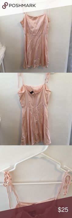 forever 21 baby pink satin dress girly soft silk semi formal mini dress with tie straps. very cute and sexy (needs to be ironed) bought from another posher but fits too small Brandy Melville Dresses Mini