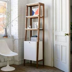 http://www.westelm.com/products/modern-narrow-tower-h1492/?pkey=cliving-room-bookcases|bookcases