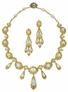 AN EARLY 19TH CENTURY AQUAMARINE DEMI-PARURE.  Comprising a necklace composed of a series of graduated oval mixed-cut aquamarine and gold repoussé scroll panels, suspending five similarly designed drop shaped pendants, to the belcher link backchain with single claw-set aquamarine highlights interspersed with gold flowerhead detail; together with a pair of similarly designed ear pendants, French marks for gold 1819-1838, 53.5cm and 7.9cm long respectively, fitted case