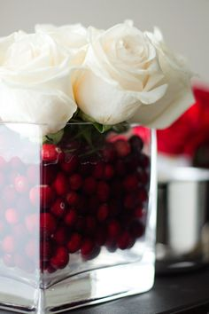 White roses and cranberries - great for Christmas centerpieces and you could diy these.