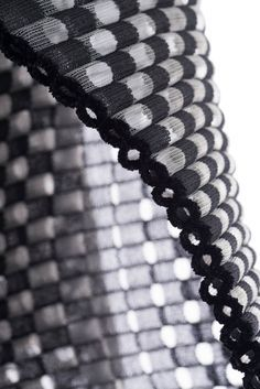 Experimental textiles design using knitting & weaving to create a cylindrical 3D fabric structure // Cecile Feilchenfeldt