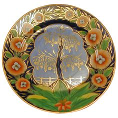 "Dramatic Coalport Tree of Life Porcelain Plate  - The tree of life, emblazoned with golden leaves, rises from the green earth, against the bluest sky. A gilded fence protects it from a field of wheat and a halo of orange flowers crowns its glory. One of the most beautiful of Coalport's Imari influenced designs it is rarely seen. It would enhance any collection of porcelain if not becoming the star attraction. Circa 1810. HEIGHT: 	.5""  DIAMETER: 	8.5"" - The Spare Room, Baltimore, MD"