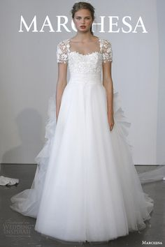 marchesa #bridal spring 2015 short sleeve #wedding dress ethereal layered skirt ruffle back train #weddings #weddingdress
