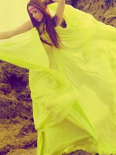 Yellow neon dress and tribal styling. Blowing wind makes it super dramatic.