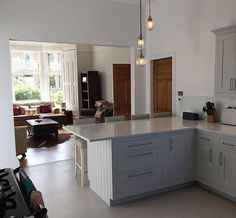 Harvey Jones shaker kitchen farrow and ball dimpse and lovely down lights from John Lewis