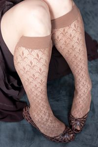 Paris Trouser Socks - Classic fleur-de-lis design in an uber-sexy net knee high.  Nylon spandex blend stretches to fit all your curves beautifully, even the narrow one above your heel.  Solid wide cuffs keep them up in comfort and style.