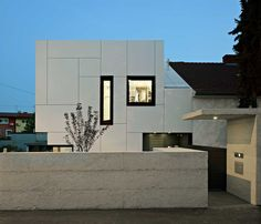 Transition from pitched roof to modern structure. Trespa Meteon #facade #white #trespa