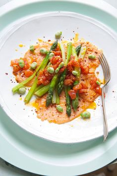Seared smoked salmon with asparagus, broad beans, tomato and garlic olive oil