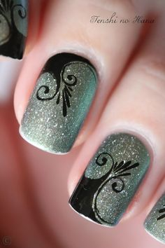 love the color contrast and style. Though it'd be cuter if they all were in the same spot with one coming out of the base. #DIYNailDesigns