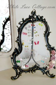 That was a table mirror. I just took the glass out and  glued screen found at the hardware store to the back. It is very pretty and makes getting her earrings very easy.