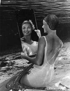 Bruce Mozert's underwater photographs of women performing above ground activities