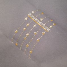 Working drawing for a multistranded yellow gold star bracelet with diamond clasp.