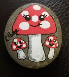Mushrooms rock painting by Rebeca Page