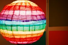 rainbow lantern by swelldesigner, via Flickr #kid #craft colored tissue paper on paper lantern