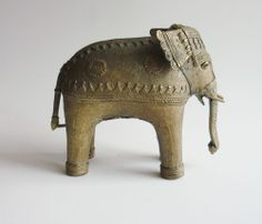 Brass Dhokra elephant from Orissa, India. Only 10 cm high. Made using the lost-wax technique.