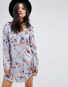 Buy it now. Glamorous Button Front Long Sleeve Swing Dress - Multi. Dress by Glamorous, Lightweight woven fabric, Unlined design, Floral print, V-neck, Button placket, Relaxed fit, Machine wash, 100% Polyester, Our model wears a UK 8/EU 36/US 4 and is 173cm/5'8 tall. An eclectic mix of vintage influences and contemporary partywear are at the heart of Manchester based label Glamorous, where individual style is the key. The carefully sourced fabrics and prints channel a fun and youthful vibe…
