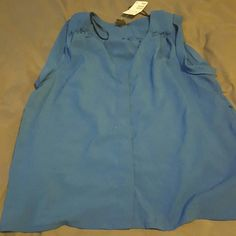Cute blue H&M blouse Cobalt blue blouse.  Sleeveless. frill on shoulders. Perfect for under a blazer.  100% polyester Brand New.  Size 8 the second picture is closer in color H&M Tops Blouses