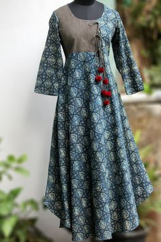 Buy Maati Crafts Blue Cotton Printed Anghrakha Kurti online in India at best price.a stunning evening dress, styled like a mughal inspired anghrakha with woollen fumdas at the end of dori. Salwar Designs, Blouse Designs, Pakistani Dresses, Indian Dresses, Indian Outfits, Kurta Patterns, Dress Patterns, Indian Attire, Indian Wear