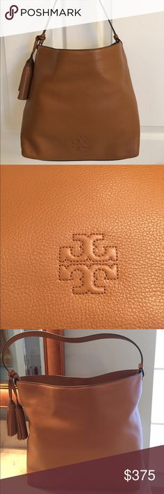 """🆕Tory Burch """"Thea"""" Hobo bag in the color bark. GORGEOUS Tory Burch Thea leather hobo bag in bark (Luggage color). The shoulder strap is flat and comfortable. The inside has the classic authentic TB jacquard lining with a large zipper pocket and 3 vertical slip pockets. Raised embossed at the bottom and hidden magnetic closure at the top. The outside has twin hanging removable tassels. Dust bag included. Approximate Measurements: 11.8"""" L x 11.4"""" H x 5.9"""" D Tory Burch Bags Hobos"""