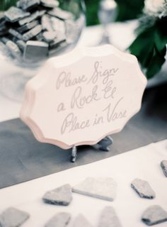 Unique Wedding Guest Book Idea...sign a rock and put it in the vase! omg...love this idea!!