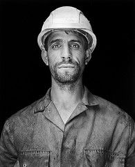 Steel Worker 9 (Peter Bongard) Tags: light portrait bw white black mamiya face contrast silver nikon faces dirt xp2 worker medium format mf 90mm coolscan ilford available reflector 9000 rollfilm rb67 steelworker sekor 9035 vuescan