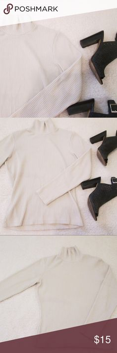 "Nordstrom beige ribbed turtleneck! 👡👝🍂 This cozy turtleneck is making a comeback! This fitted top is perfect with dark skinny jeans or layered for a cold winter day! It is in perfect condition. Last photo of similar shirt for fit and style reference only. Runs small. The neck is pretty snug. Measurements: Bust: 34"" Arm length: 20"" Length: 20.5"" Fabric is 53% polyester 42% cotton 5% spandex. Machine wash warm. 🍂bundle with just one other item for 15% off! ❤️ Sweaters Cowl & Turtlenecks"
