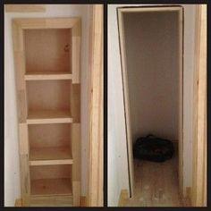 Hidden Bookcase Door Conceals Gun Closet - bookcase rolls out of way to reveal secret closet