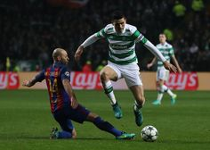 Javier Mascherano of Barcelona (L) tackles Tomas Rogic of Celtic (R) during the UEFA Champions League Group C match between Celtic FC and FC Barcelona at Celtic Park Stadium on November 23, 2016 in Glasgow, Scotland.