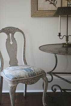 Lovely chair with soft blue & white patterned fabric & THAT table!  (from Tone on Tone)