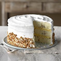 This recipe truly lives up to its name. The pecan-dotted cake is stacked in three layers, and made-from-scratch frosting is the crowning touch. Gâteau Tres Leches, Just Desserts, Dessert Recipes, Layer Cake Recipes, Elegant Desserts, Layer Cakes, Pecan Cake, Fall Cakes, Butter Pecan