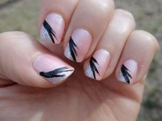 My first attempt at nail art. I was going to do just a single black line beside the silver but had to do the feathery thing to cover up how bad that turned out! lol