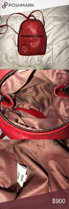 Stella McCartney mini Falabella backpack 🎒 Red Stella McCartney mini shaggy deer backpack. Excellent like new condition only worn twice. Dust bag included. I've never seen this color anywhere else. RARE. Stella McCartney Bags Backpacks