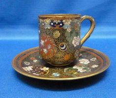 ANTIQUE CLOISONNE CUP AND SAUCER
