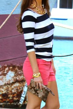 Pink shorts and striped top.