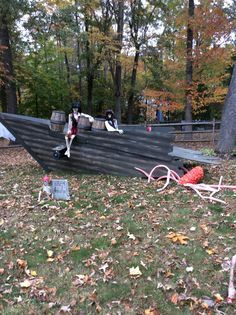 My tribute to Pirates of the Caribbean...believe it or not this boat made it thru a hurricane last year - flipped completely over pieces in the neighbors yard and resurrected for 2015 :). See the insides - Kim's haunt 2014 Halloween yard board