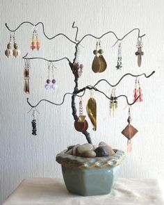 Earring tree.  The site does not give step by step instructions but it does list what is needed.  I don't think it would be hard to figure out from that.