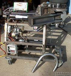 Hydraulic Tube Bender by TheBandit -- Homemade hydraulic tube bender fabricated from steel stock and capable of producing 180 degree bends in a single stroke. Controlled by a PLC. http://www.homemadetools.net/homemade-hydraulic-tube-bender-2
