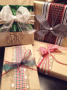 DIY Christmas Wrapping: butcher paper and DIY Christmas bows with houndstooth, plaid, and pearls.