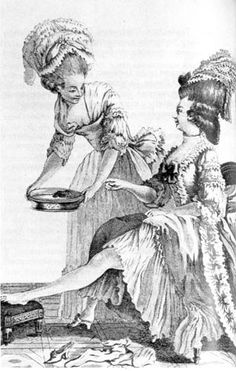 Ladies maid provides a foot bath for her mistress