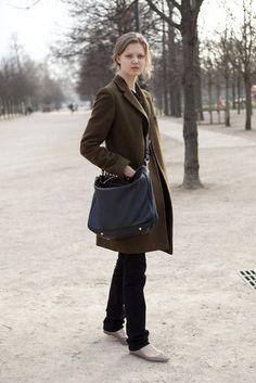 Winter style basics: statement cross body bag, ballet flats, black skinnies, and green winter coat