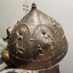 Burial of a Thracian auxiliary soldier (Eftatralis?) from Kara Agach/Bryastovets 4: detail of helmet with Apollo and Athena | by diffendale