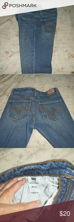 Levi straight legs Size 5 straight leg levis worn one time by myself and are too large. These are like New. Levi's Jeans Straight Leg