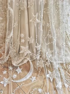 Moon and stars embroidered wedding dress in ivory beaded tulle over silk satin, with detachable separate long sleeves and crystal sparkles